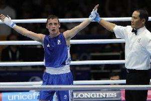 Boxer Reece McFadden celebrates winning a bronze medal at Glasgow 2014. This will be his minimum achievement in the 2018 version of the Games on Australia's Gold Coast.