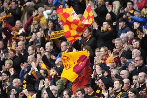 Motherwell supporters celebrate their team's 3-0 victory over Aberdeen at Hampden of Saturday. Pic: Alan Murray