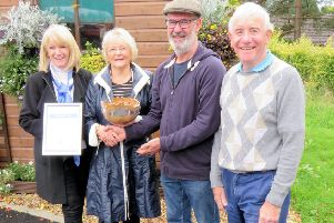 Liz Wilson (second, left) and Sandy Robertson (right) of Uddingston Pride present the allotments award to Susanne Mallin and Kevin Gough