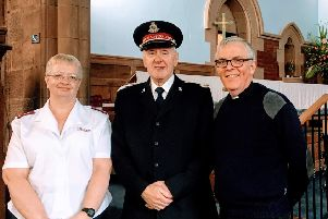 The Rev Richard Kilgour of Holy Trinity Church with the Salvation Army's Janie Paterson and Motherwell Band Master William Friend