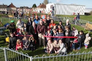 Thorniewood councillor Bob Burrows cuts the ribbon to officially open the play park in Birkenshaw