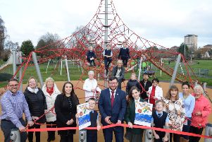 Councillor Paul Kelly cuts the ribbon to officially open The  Steel Town Play Park