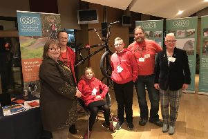 Dan Scott and Fred Crowson from Social Track, Jayme Leigh Halford from Berryhill Primary and Logan Kirk from Clyde Valley High are joined by Clare Adamson MSP and Councillor Agnes Magowan as the work of Wishawhill Wood Pump Track is showcased at the Scottish Parliament