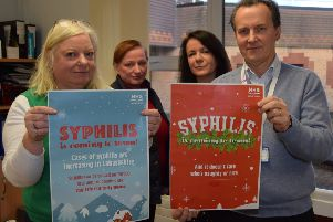 Showing off some examples of the social media images being used to raise awareness of syphilis are (l-r) Dr Anne McLellan (lead clinician for the Lanarkshire Sexual Health Service), Trish Tougher (Lanarkshire BBV prevention & care network manager), Jacqueline Martin, (senior health promotion officer), Dr John Logan (consultant in public health medicine)