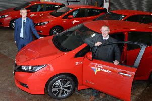 Business Manager (Transport) Graham Johnstone is pictured with Councillor Michael McPake, convener of the Infrastructure Committee, and some of the new electric cars