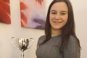 Caitlin Agnew shows off her runners- up trophy from the Listen Up Music Songwriter's Festival in London