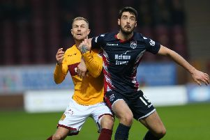 Ross County's two-goal hero Brian Graham (right) with Motherwell's Richard Tait (Pic by Ian McFadyen)