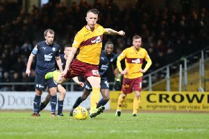 David Turnbull fires in Motherwell's winning goal at Dens Park from the penalty spot (Pic by Ian McFadyen)