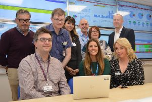 Front (left to right): Dr Gordon McNeish, consultant in emergency medicine, Donna McHenry, assistant service manager, and Karen Goudie, University Hospital Monklands chief of nursing service, with senior staff from University Hospital Monklands and NHS Lanarkshire