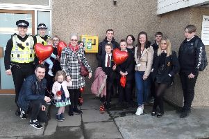 Heather Liengie (tartan coat) from Mossend fundraised for the defibrillator which she has dedicated to her son Mark who died suddenly from cardiac arrest in 2001