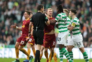 Players from both sides argue after Gboly Ariyibi's controversial strike for Motherwell at Celtic Park on Sunday (Pic by Ian McFadyen)