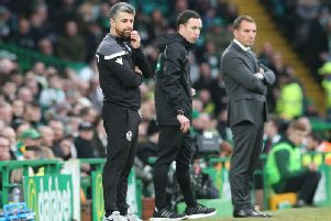 Stephen Robinson and Brendan Rodgers watch Sunday's action at Celtic Park (Pic by Ian McFadyen)