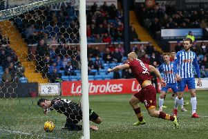 Killie keeper Daniel Bachmann almost fumbles Richard Tait's overhead kick into his own net in the first half (Pic by Ian McFadyen)