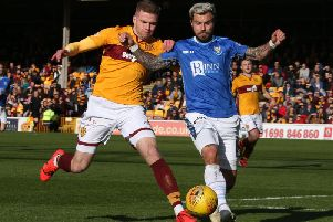 Motherwell and Scotland midfielder Chris Cadden battles against St Johnstone's Richard Foster (Pic by Ian McFadyen)