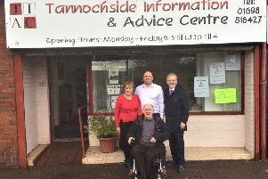 Tannochside Information and Advice Centre staff and management committee members with Thorniewood councillor Bob Burrows
