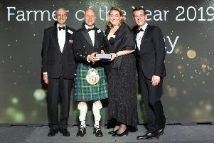 Cream of Galloway's David Finlay (in kilt) accepts Farner of the Year Award. Ap. 2019