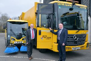 Councillor Michael McPake with John Stewart , assistant business manager of Fleet Operations