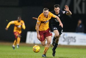 Allan Campbell races away from Dundee opponent during Motherwell's 1-0 win at Dens Park on January 26, the sides' last meeting. (Pic by Ian McFadyen)