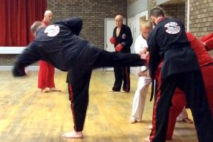 Paul Burns shows off his Taekwondo skills