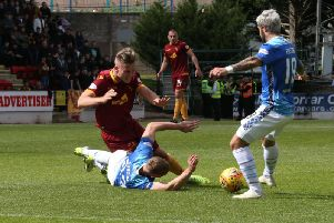Motherwell's James Scott takes a tumble at Perth (Pic by Ian McFadyen)