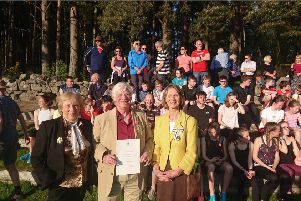 Banchory Stonehaven AC coach Willy Russell gets BEM at Alexander Park, Banchory. Pictured: Sandra Russell, Willy Russell and Carol Kinghorn, the Lord Lieutenant of Kincardineshire.