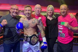 Celtic champ Cameron Kerr is pictured with promoter Frank Gilluley, his wife Kerry and corner men