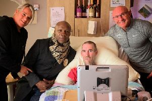 Chris Eubank is pictured with Frank Gilluley and his wife Kerry during a recent visit to see ex-Rangers star Fernando Ricksen at St Andrews Hospice in Airdrie