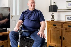MND Scotland recently found a mobility scooter which Ian Cartwright can use to get around at at work
