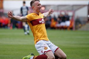 David Turnbull does a knee slide celebration after scoring against St Mirren last season (Pic by Ian McFadyen)