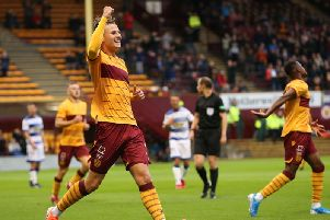 James Scott celebrates after putting Motherwell ahead against Morton (Pic by Ian McFadyen)