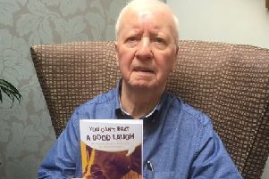 Lithlithgow pensioner Bill Townley with a copy of his joke book he is selling in aid of Chest Heart & Stroke Scotland