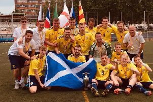 Former Bishopbriggs Academy pupil Ross Russell (centre row, right) celebrates with his Scotland team-mates