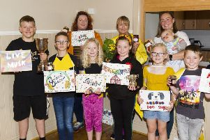 Making preparations for Ancrum's first village show for years are, back from left, Fizz Calder, Shona Sinclair and Jill Evans, with, front, Iver Coyle, Toby Anderson, Erin Scott, Abbie Cargill, Olivia Sandilands and Aaron Cargill.