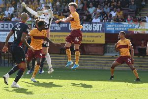 Jermaine Hylton (1st right) in action against Ross County on Saturday (Pic by Ian McFadyen)