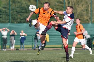 Action from Saturday's Braves-Rothes clash