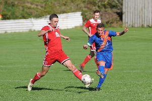 Aidan Reilly looks to pass the Easthouses Lily defender (picture: Grant Kinghorn)