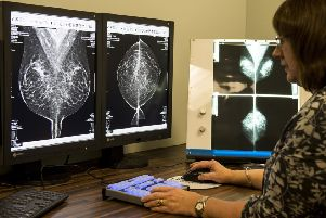 A specialist analyses the data from screenings of a mammogram which has a potentially lifesaving effect ' yet uptake for the test is not as it should be