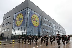 North Lanarkshire Schools' Pipe Band perform at the opening of the Lidl distribution depot