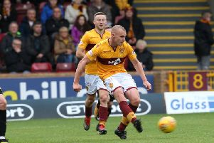 Liam Grimshaw and Allan Campbell in action against Livingston at Fir Park last season (Pic by Ian McFadyen)