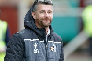 A smiling Stephen Robinson surveys Motherwell's 2-1 home win over Livingston on Saturday (Pic by Ian McFadyen)