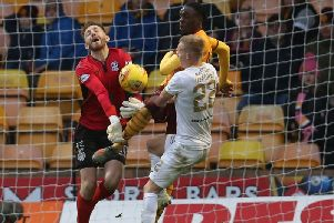 Motherwell keeper Mark Gillespie thwarts Livingston attacker Scott Tiffoney (Pic by Ian McFadyen)