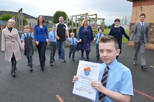 Pupils and staff at St Teresa's with the Autism Toolbox which was launched recently by Education Scotland