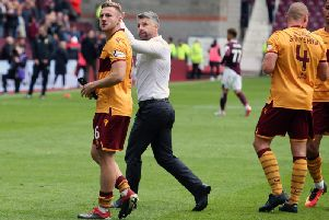 Stephen Robinson and his players celebrate after winning 3-2 against Hearts at Tynecastle in the sides' last league meeting in September.