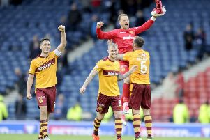 Trevor Carson celebrates Motherwell reaching the 2017 Betfred Cup final with jubilant team-mates Carl McHugh, Richard Tait and Peter Hartley (Pic by Michael Gillen)