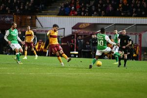 Motherwell's Liam Donnelly unleashes a shot at goal against Hibs on Saturday (Pic by Ian McFadyen)