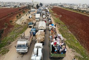 Displaced Syrians driving through Hazano in the northern countryside of Idlib, after fleeing on January 28. Pic:  Getty Images