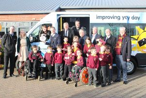 Some pupils last year with their new minibus