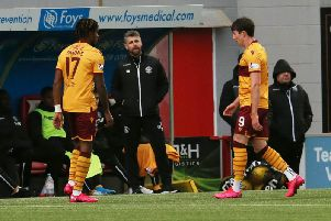 Motherwell manager Stephen Robinson looks none too pleased with Chris Long as the striker walks off after receiving a red card at Hamilton (Pic by Ian McFadyen)
