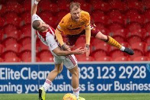 Richard Tait (right) battles with Accies defender Alex Gogic last Saturday (Pic by Ian McFadyen)