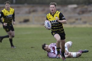 Murdo McAndrew of Melrose breaks clear after evading an attempted tackle by Watsonians' Mike Fedo. Picture: Neil Hanna.